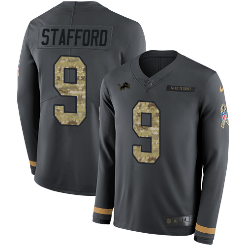 Nike Lions #9 Matthew Stafford Anthracite Salute to Service Men's Stitched NFL Limited Therma Long Sleeve Jersey